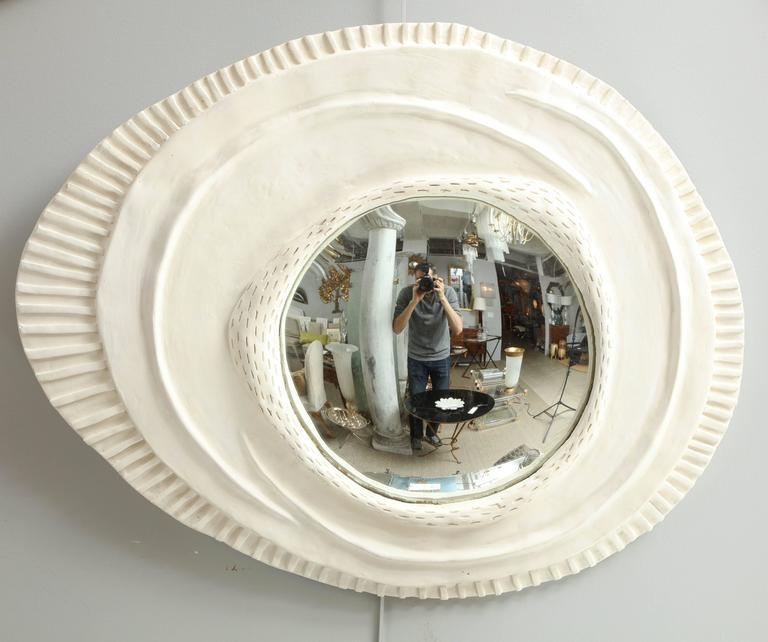 Handcrafted by an artist in France, these unique pieces are made up of a plaster frame surrounding  a concave mirror.  Priced separately at $1800 each.