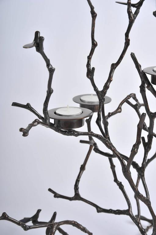 Handmade cast bronze. Tiny birds and candle holders nestle in delicate cast bronze twigs.