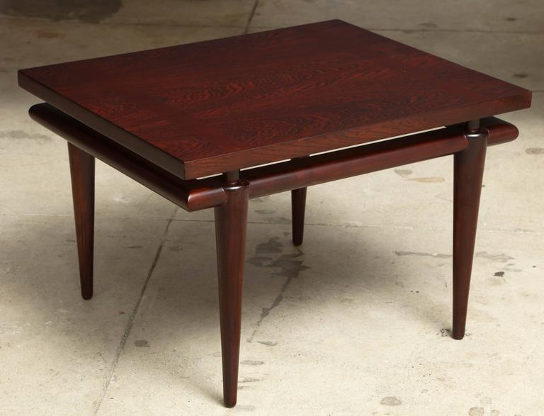 Pair of Mid-Century Modernist Classic Rosewood side tables with tapered legs and inset bands of wood on top. Mint restored.