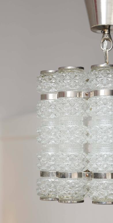 Scandinavian Modern Orrefors Chrome and Crystal Pendant Fixture Mid-20th Century For Sale
