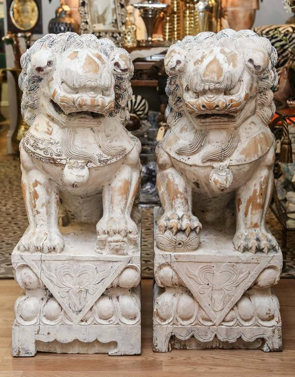 Chinese Pair of Carved Wood Painted Foo Dogs For Sale