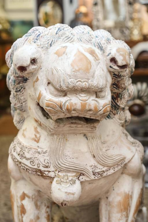 Pair of Carved Wood Painted Foo Dogs In Good Condition For Sale In West Palm Beach, FL