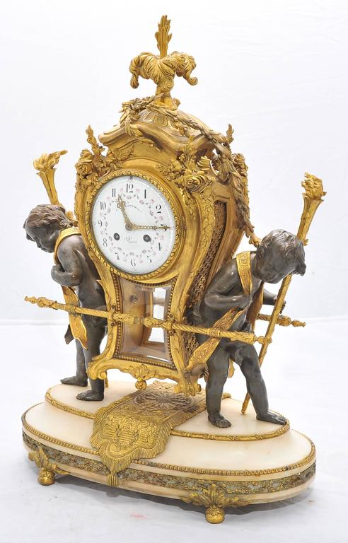 A very impressive good quality 19th century French gilded ormolu, bronze and white marble mantel clock. Having scrolling foliate and ribbon decoration, two putti carrying the eight day striking clock. Mounted on a white marble ormolu-mounted plinth.