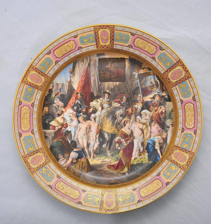 A large and impressive, fine quality Vienna porcelain charger, having a hand-painted scene depicting Kaiser Karl V in Antwerp. Vienna porcelain mark to the base.