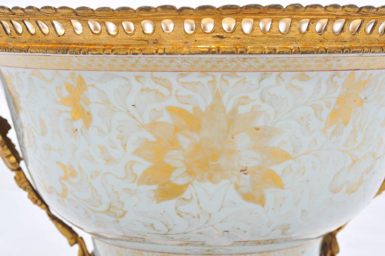 A very impressive 18th century Chinese export porcelain bowl, having gilded floral decoration, wonderful gilded ormolu handles and base with scrolling foliate detail.