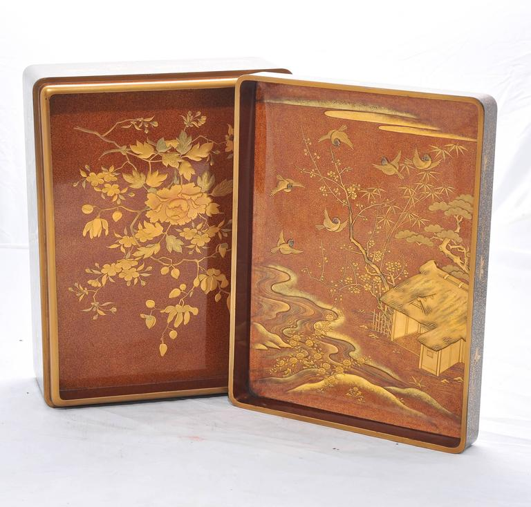 A fine quality Japanese late 19th century lacquer book, having wonderful gilded flower and foliate decoration to the out side and in.