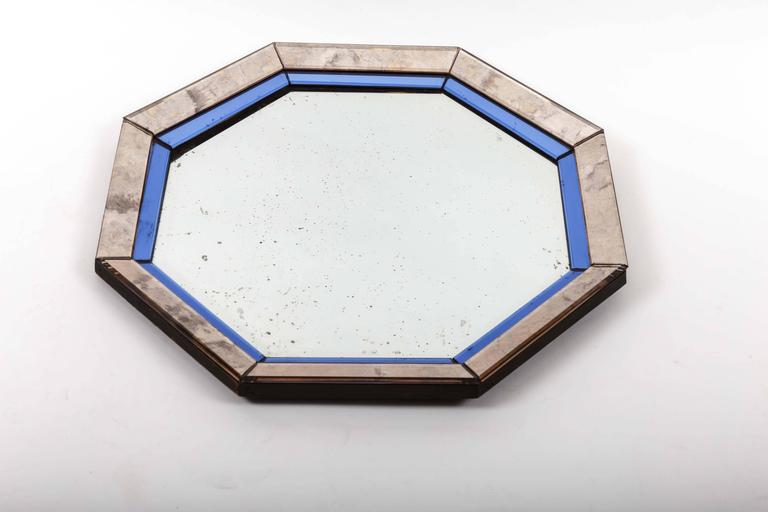 Mirror in an octagonal shape with blue and antiqued silver frame.