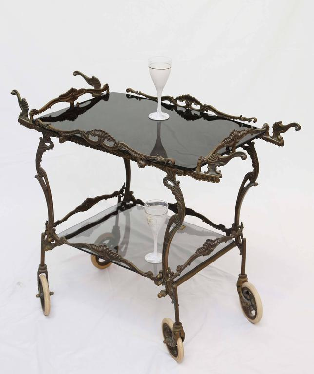 All is original on cart with the exception of the bottom glass shelf where the screws are missing. We have not cleaned the bronze; the cart is in vintage condition. We set a fair price, since we lack identification, it could be a highly