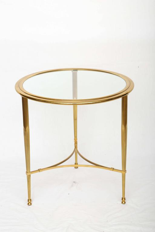 Hollywood Regency Bronze Glass Top Side Table With A Very Decorative Base.  The Glass Is