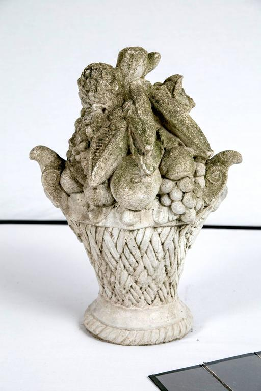 Cast stone garden ornament, basket of fruit, circa 1920. Wonderfully detailed with aged patina. A perfect addition to the garden or as indoor decoration.