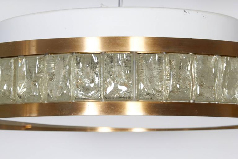 Perzel ceiling fixture made of brass and glass segments, the bottom in white milky glass. There are four sockets inside.