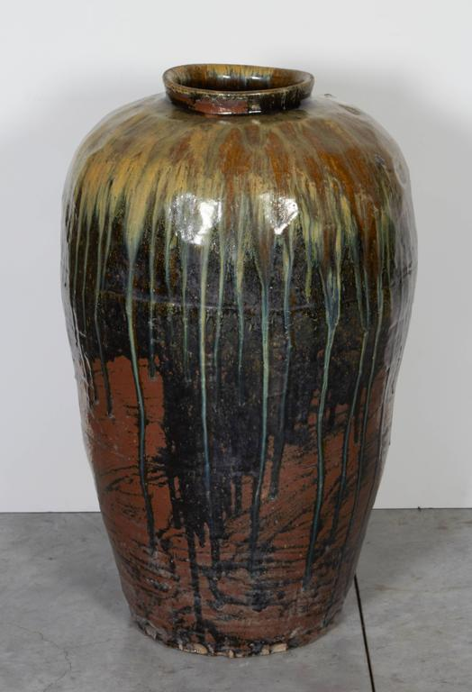 A very tall, multi-color antique Chinese ceramic jar from Shanxi Province. Beautifully glazed and gracefully shaped. CR713.