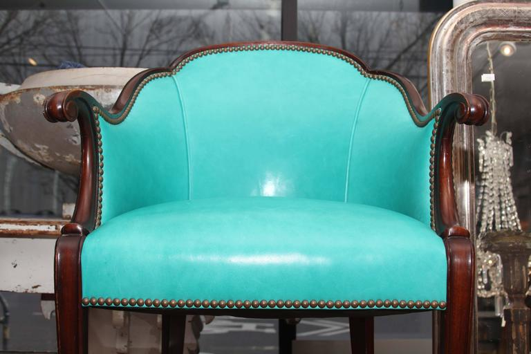 Antique English side chair newly upholstered in peacock leather with nail head trim.