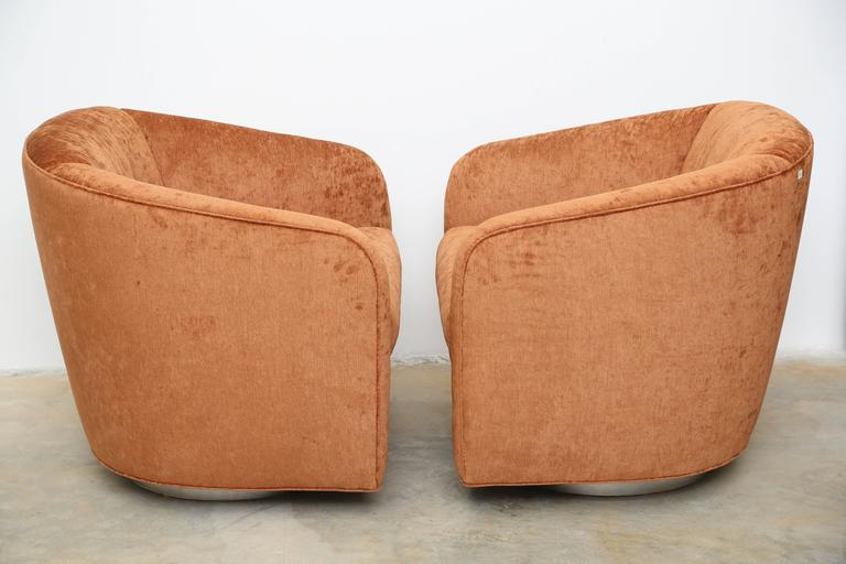Pair of very comfortable swivel armchairs, re-upholstered in a soft velvet fabric. Midcentury.
