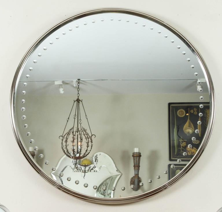 impressively scaled round mirror with antique silver finish for sale at 1stdibs. Black Bedroom Furniture Sets. Home Design Ideas