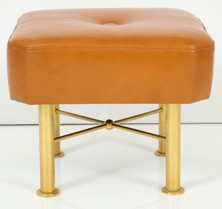 Leather upholstered stool with a gilt brass base.