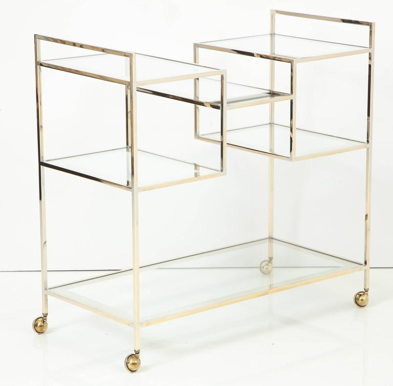 Bar cart, circa 1960, very light color brass with mercury edge glass shelves with many decorative levels.