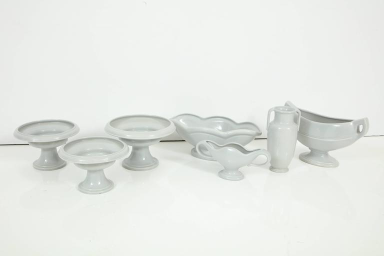 A series of grey-blue glazed Fulham Pottery vases, England, circa 1930-1940. Each piece is slightly different, but they all have a beautiful simplicity. Each piece is striking on its own, but they look stunning in a group. Priced separately