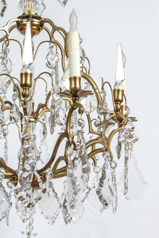 1970s Eight Light Bronze And Crystal Chandelier For Sale