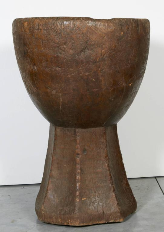 A gracefully shaped, wide mouth mortar with beautiful patina, carved out of a single piece of teakwood. From Java, Indonesia, circa 1930s. M2020.