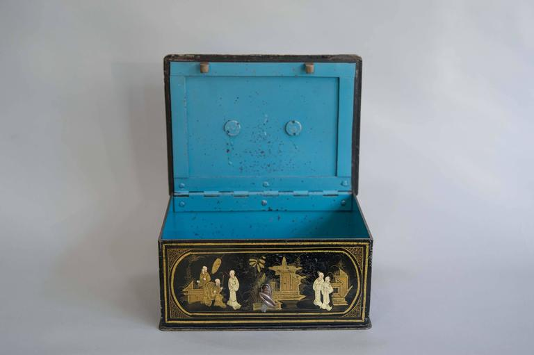 A very charming early 19th century chinoiserie decorated strong box. Made between 1820-1850 in France or Germany. The box retains its original blue decorated interior and its key. The Georgian style handle is also very boldly cast. The decoration is