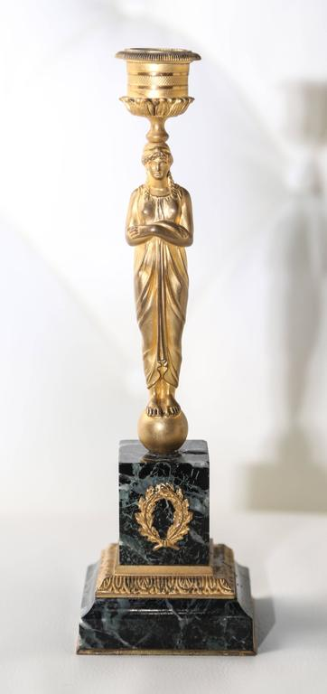 Fashioned with Classic bronze figures mounted on green marble bases.
