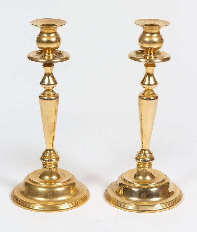 Pair of Victorian brass candleholders. Elegant pair of polished brass Anglo Indian candlesticks. Great brass decorative cast iron brass art objects.