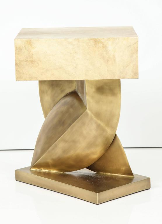 Goatskin parchment side table with a fantastic bronze base. France. We have it on display at our 1stdibs showroom.