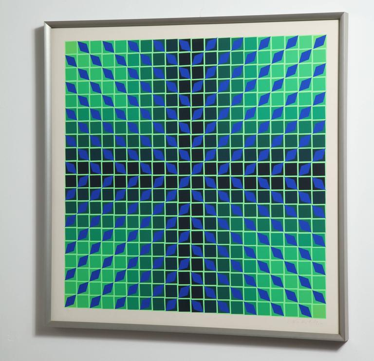 Op Art serigraph from Hungarian/French artist Victor Vasarely, signed in lower corner and numbered 32/250. The original work is professionally framed in a matte brushed aluminum frame.