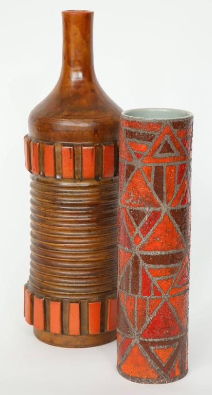 Complimentary pair of Italian ceramic vases in tones of brown and burnt orange, the smaller one featuring a geometric pattern and a sand glaze technique.