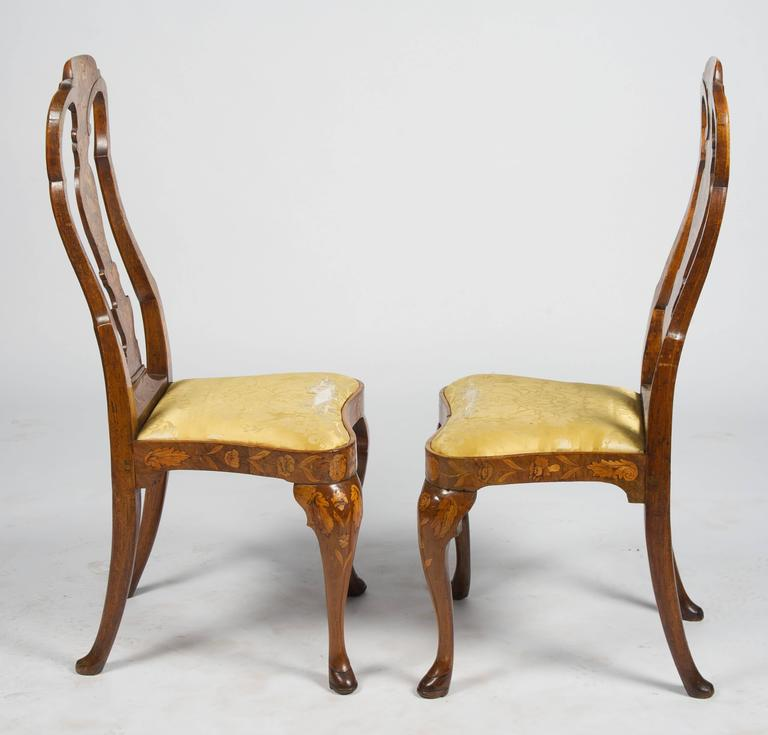 A Good Quality Pair Of Walnut, 18th Century Dutch Marquetry Side Chairs.  The Back