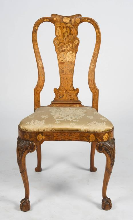 A fine quality set of four, 18th century Dutch marquetry side chairs. Each with wonderful vase shaped splats with flowers, leaves and birds inlaid, also to the apron. Drop in seats and raised on finely carved cabriole legs terminating in pad feet.