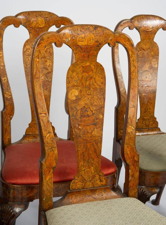 A good quality set of six 18th century Dutch marquetry chairs, each having flowers, leaves, birds and urns inlaid to the backs and apron. Drop in seats and raised on carved cabriole legs terminating in pad feet.