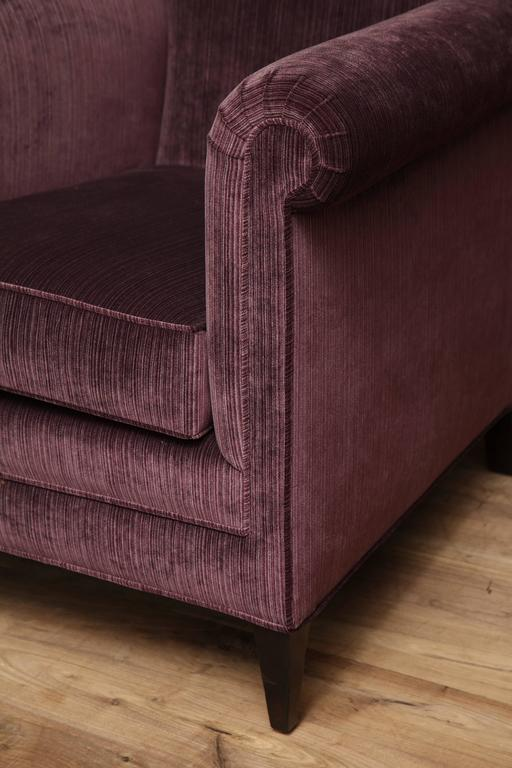 English club chair upholstered in eggplant strie velvet, circa 1930.