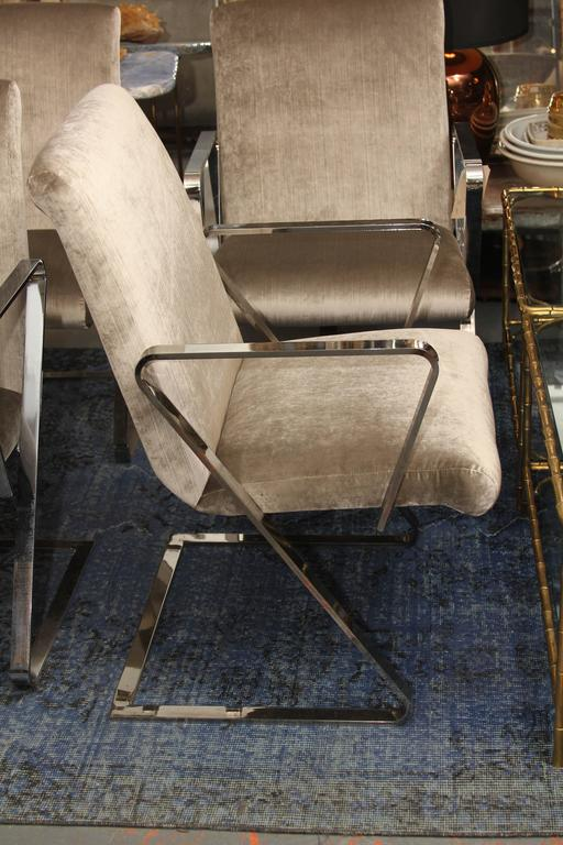 Pair of springer style chairs with heavy chrome frame upholstered in beautiful silk velvet. Each pair priced at 3800. Perfect side chairs or dining chairs. These are super comfortable and the spring factor make these chairs the ones you will want to