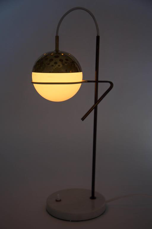 1960s Stilux Milano glass and marble table lamp. Retains original manufacturer's label. This extremely rare and iconic lamp is executed in original opaline glass, lightly patinated brass, painted metal and Italian marble in very good vintage
