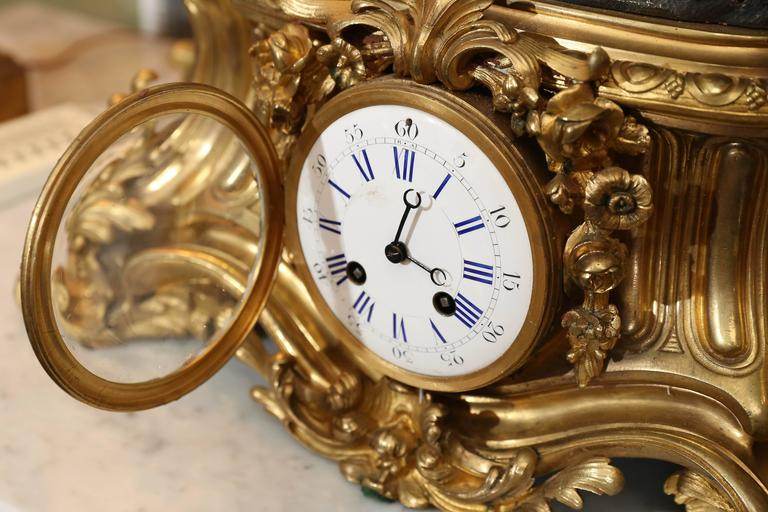 Large 19th Century Gilt Bronze Clock with Patinated Putto Mounted on the Top For Sale 3