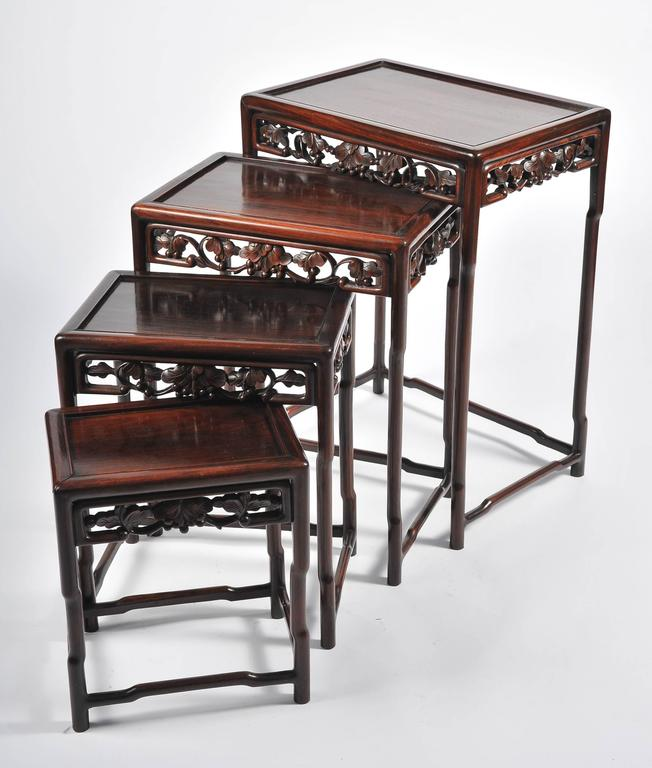 A good quality nest of four 19th century Chinese hardwood tables. Having carved foliate decoration to the frieze.