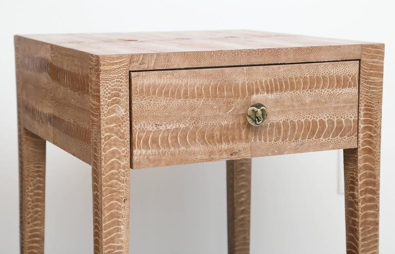 Pair of snakeskin bedside tables with one drawer each-finished all the way around. Transitional enough to be used as bedsides of sofa tables.
