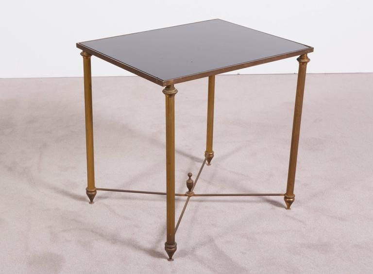 Neoclassical black glass top bronze nesting tables manner for Glass top nesting tables
