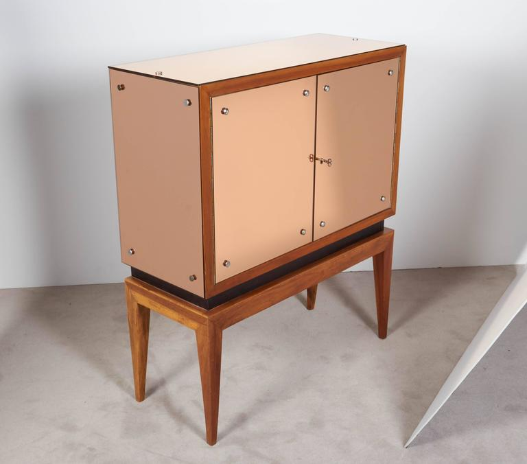 Glass Mid-Century Modern Locking Cabinet with Rose-Tinted Mirrors For Sale