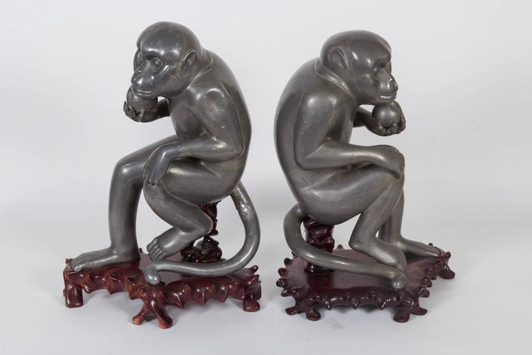 Carved Pair of Chinese Export Pewter Monkey Sculptures on Bases For Sale