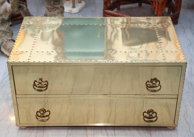Generously scaled and fitted with two drawers and appointed with brass studs nicely polished.