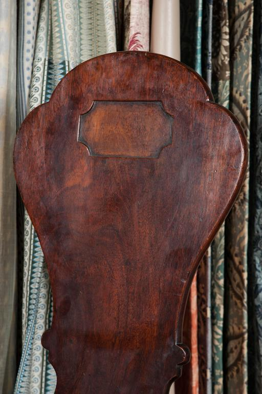 18th Century Pair of George II Mahogany Hall Chairs For Sale