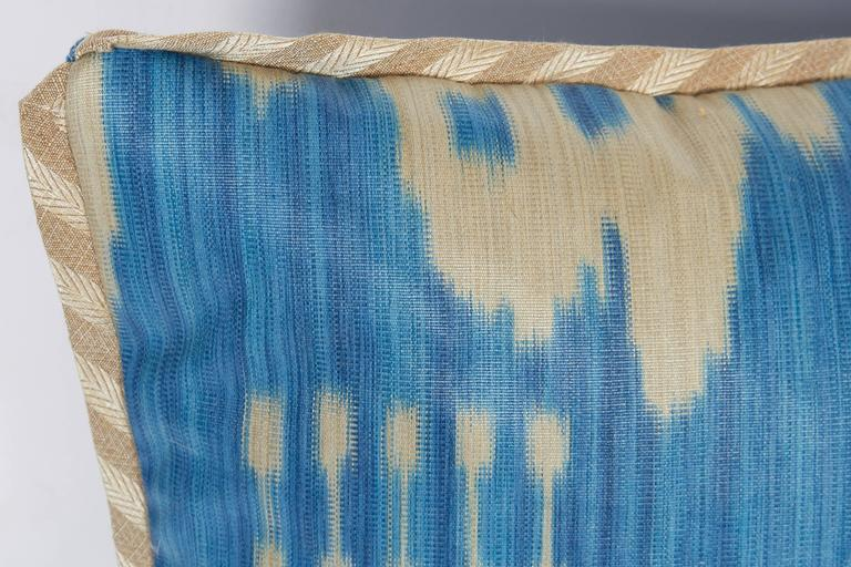 A single Ikat fabric cushion, with silk blend bias trim and linen backing. Newly made using vintage fabric, circa 1960
