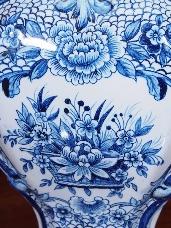 Pair of Delft Garniture Vases with Lion Finials 4