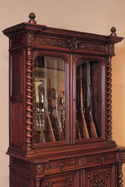 Store your rifle collection inside this beautifully carved, antique gun  display cabinet. Created in - 19th Century French Carved Oak Eight-Gun Display Cabinet With Hunt