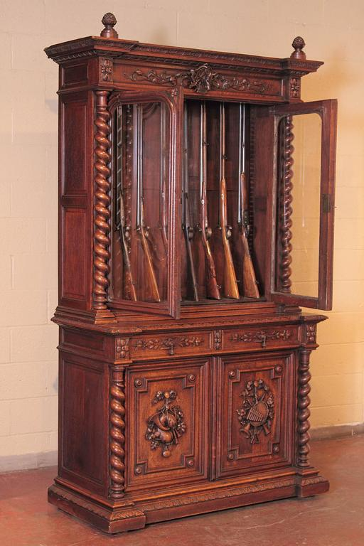 19th Century French Carved Oak Eight Gun Display Cabinet