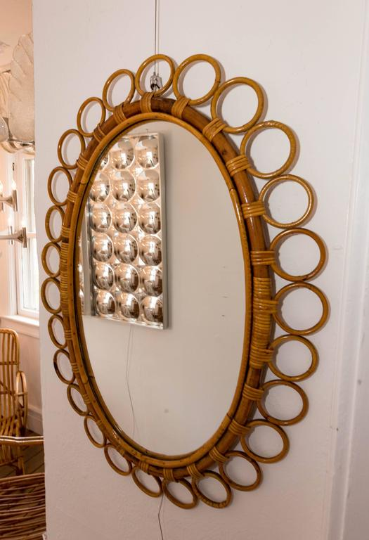 Oval bamboo surround mirror.