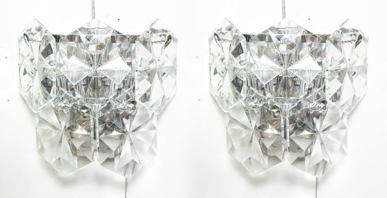 Pair of glamorous 1970s Kinkeldey oversized crystal sconces.